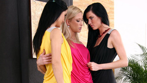 Uma, Danae and Erika F - Uma (blonde), Erika (yellow dress) and Danae have a three way lesbian orgy in the living room.  The girls start kissing each other and suck each others nipples while slowly undressing each other.  Then Erika finger fucks Danae whi