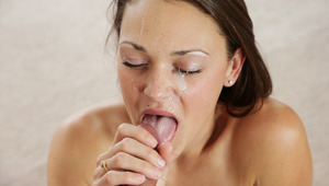 Olivia receives a hot cumload on the face after blowjob