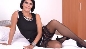 Horny mature slut masturbating on her bed