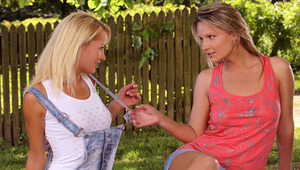 Sunshine and Jolie - Angelic blondes Jolie in red top and Sunshine in white top, embrace and kiss tenderly on a blanket in the garden, then they take off their tops to lick and fondle one anothers' beautiful breasts and hard nipples. Sunshine slides
