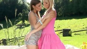 Morgan and Nela - Gorgeous teens Morgan, brunette and Nela, blonde, embrace and make out passionately in the garden. They strip off each other's clothes, then sit down on a couch to fondle and suck one another's firm tits and nipples. They slide