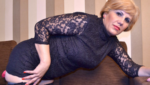 Naughty blonde mature slut masturbating on the couch